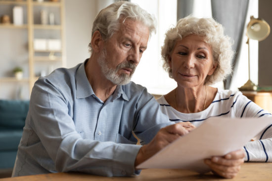 couple read insurance terms