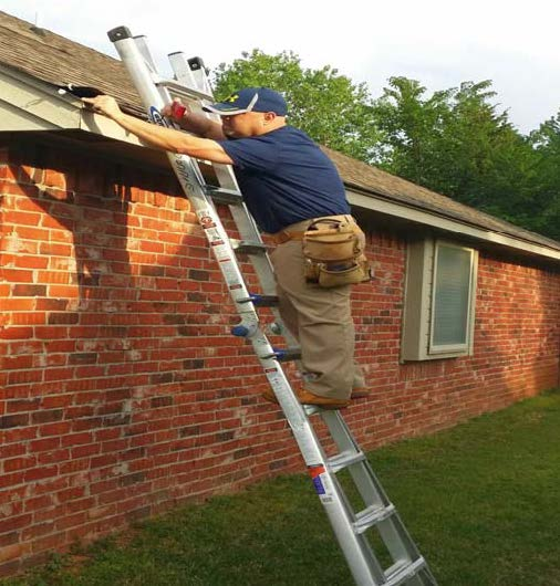 Donnie Seburg, inspecting roof damage after the storm